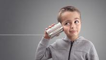 Boy On Tin Can Phone Listening...