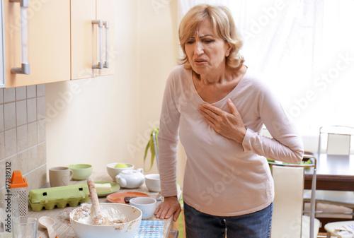 Woman having heart attack at home Canvas Print