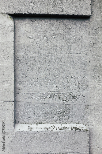 Paint covering graffiti markings on concrete wall, close up