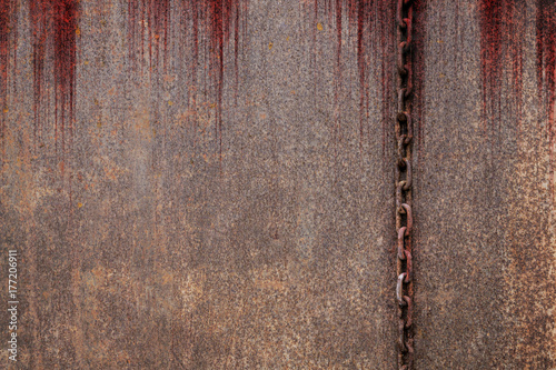 Foto op Aluminium Leder Bloody background scary old rusty chains hanging on rusted steel wall, concept of horror and Halloween