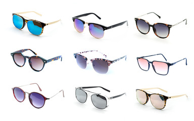 Group of beautiful sunglasses isolated on white background