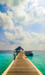 Tropical island vacation image, jetty on the turquoise blue water