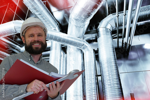 engineer against Ventilation pipes of an air condition Canvas-taulu