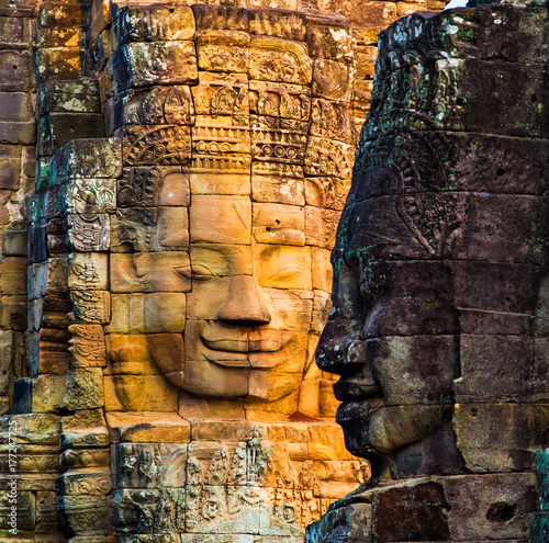 Stone murals and statue Bayon Temple Angkor Thom Canvas Print