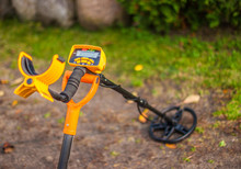 Search For Treasure Using A Metal Detector