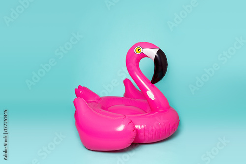 Fotobehang Flamingo Pink, trendy, blown beach flamingo on a blue background. Hit the summer