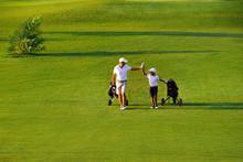 Man With His Son Golfers Walki...