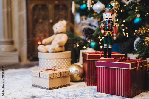 picture of decorated christmas or new year tree with many gifts against home interior handmade - How Many Gifts For Christmas