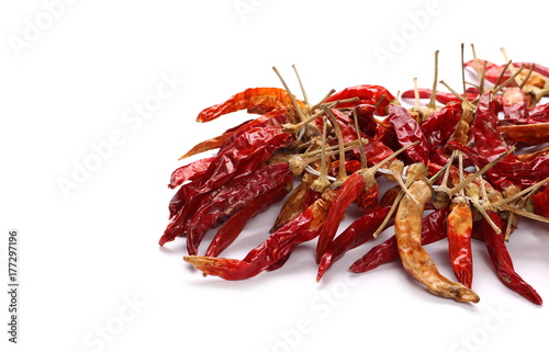 Fotobehang Schaaldieren Dry red hot chili peppers, pile isolated on white background