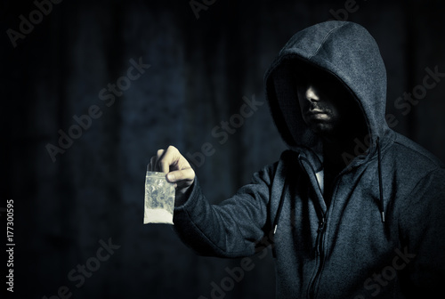 Photo  Drug dealer in the dark