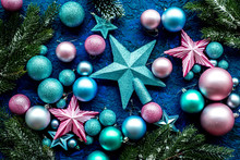 Christmas Tree Decorations With Balls And Stars Toys On Blue Background Top View Pattern