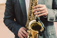 Man Playing Saxophone Outdoors
