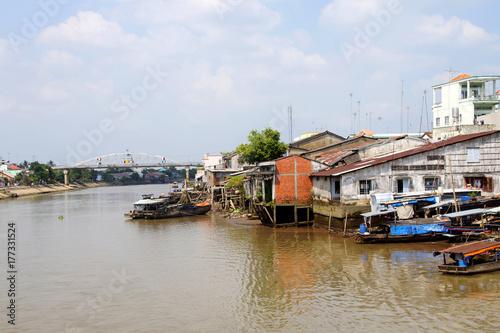Spoed Foto op Canvas Zanzibar Small working boats on Mekong river