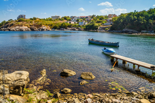 City on the water Coastal landscape - the wooden pier and boats in rocky bay, near city of Sozopol on the Black Sea coast in Bulgaria