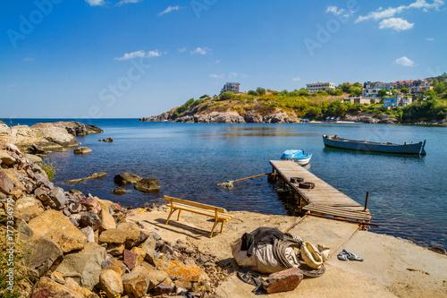 Foto auf AluDibond Stadt am Wasser Coastal landscape - the wooden pier and boats in rocky bay, near city of Sozopol on the Black Sea coast in Bulgaria