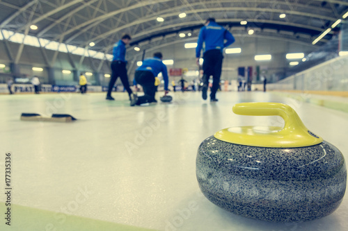 Fotografía Curling stone on a game sheet.