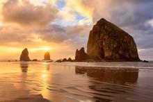 The Sun Sets Behind Haystack Rock Off The Oregon Coast