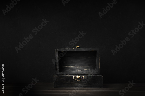 Fotografie, Obraz  Old Dark Wooden Treasure Chest with Opened Lid on Black Background