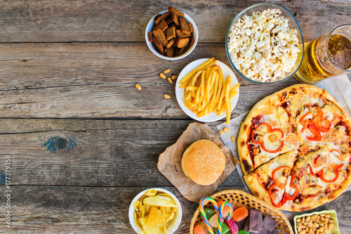 Fast food on old wooden background. Concept of junk eating. Top view.  © Victoria М