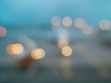 Bokeh Out Of Focus Lights Looking Out At Airplane On Runway