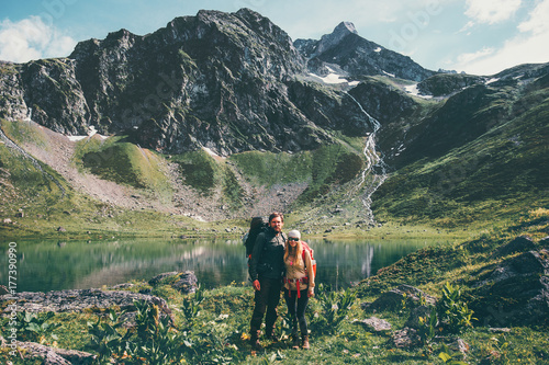 Couple Man And Woman Hiking Together At Mountains Love And Travel
