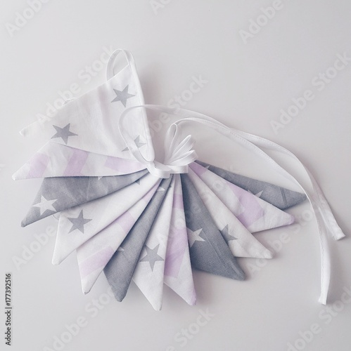 Decor garland of textile cotton flags on a satin ribbon for