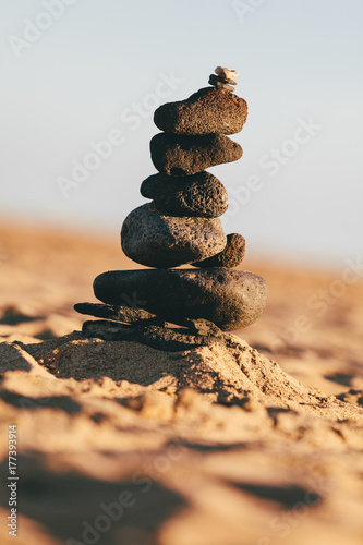 Stones Balanced on Top of Each Other on a Sandy Beach