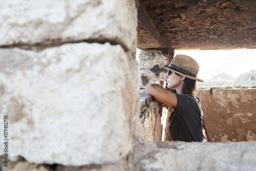 Spain, Menorca, woman inside building looking at view
