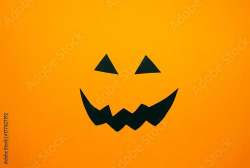 Photo  Paper Jack O'Lantern face on orange background