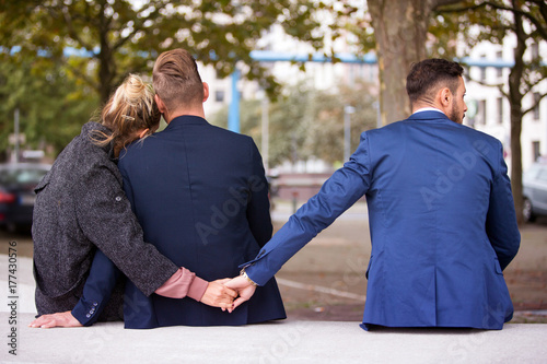 couple hugging while the woman holding hands with another man Canvas Print