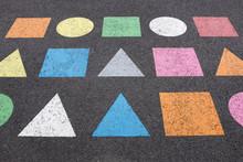 Colorful Basic Shapes Sprayed On Asphalt