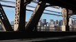 A passenger's perspective driving over the Ed Koch Queensboro Bridge with the Manhattan skyline in the distance.