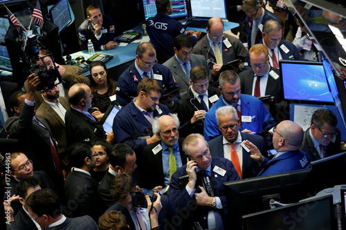 Traders gather for the IPO of Singapore-based Sea Limited on the