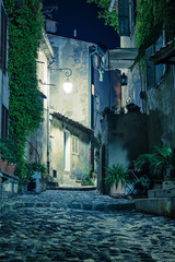FototapetaNarrow street in the old town in France at night
