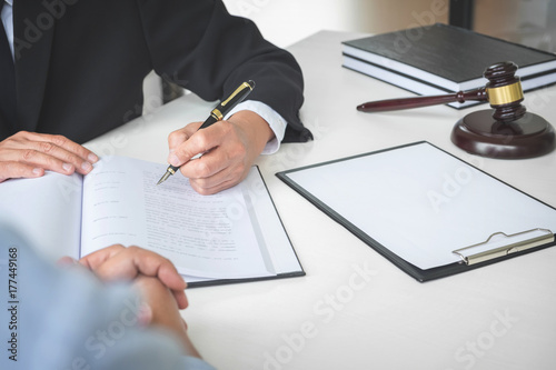 Valokuva  Close up of gavel, Male lawyer or judge Consult with client and working with Law