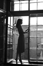 Woman Standing On The Window In Old House