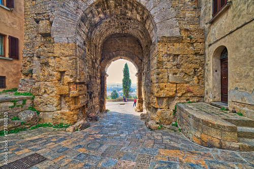 stone arch in street of Volterra