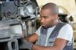 mechanic working in repair garage car maintenance