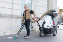 Man Using Street Cleaning Mach...