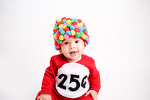 Adorable Baby Wearing Gum Ball...