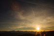 Sunset over the mountain range. fantasy sky and mountains landscape.