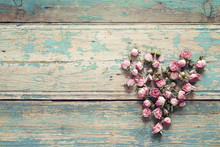 Heart From Dried Rose Flowers On The Turquoise Old Wooden Background With Copy Space. Flowers Composition.