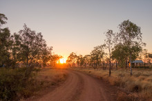 Sunrise View Of Gravel Road An...