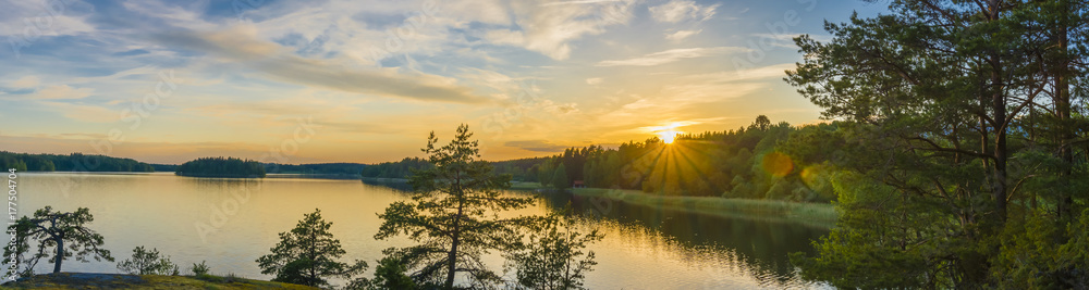 Fototapety, obrazy: Panorama picture taken in Sweden with sunset over a lake and beautiful glow from the sun