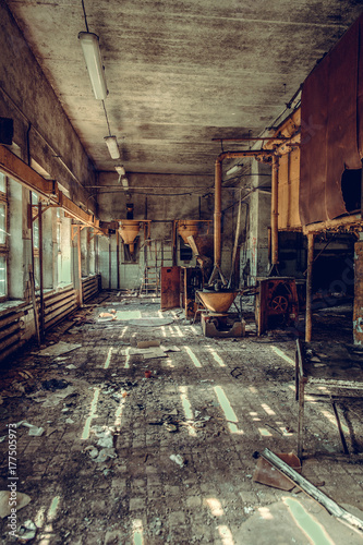 Destroyed and abandoned factory shop, complete mess and desolation. Remains of equipment and interior.