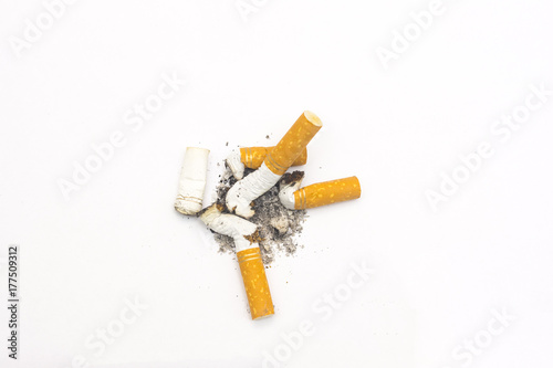 Fényképezés  cigarette butts on a isolated white background close up composition photography