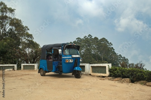 Wall Murals Old cars A means of transport called the TUK TUK at the top of the hill, called