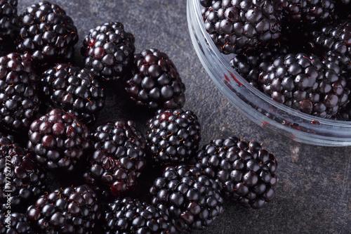 Freshly picked blackberry on dark table.