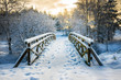 Snowy, wooden bridge in a winter day. Stare Juchy, Poland