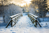 Fototapeta Most - Snowy, wooden bridge in a winter day. Stare Juchy, Poland